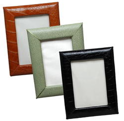 reptile-grain leather 5 x 7 picture frames, shown in luggage, jade and black