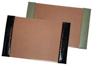 crocodile-grain leather desk pads, shown in jade pebble lizard and black alligator leather