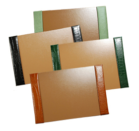 crocodile-grain leather desk pads, shown in jade pebble lizard, black, hunter and luaggage alligator leathers