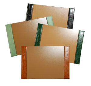 crocodile-grain leather desk pads, shown in black, jade, hunter and luaggage leather